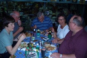 full tables and large Canadians eating BBQ at Billy's in Hua Hin